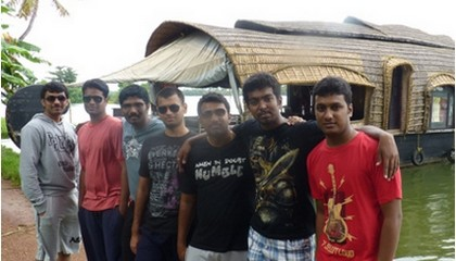 John with friends in Kerala.