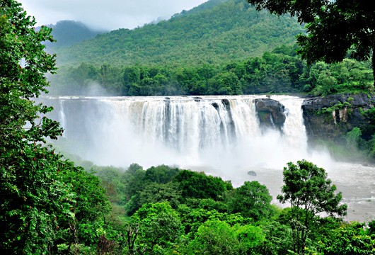 Waterfalls are at their glorious best when you come to enjoy Monsoon Tourism in Kerala