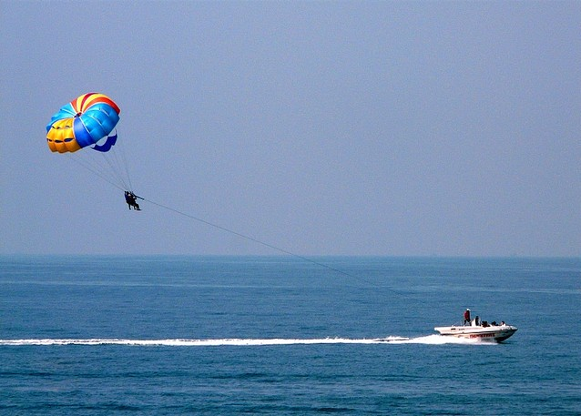 Parasailing is a water sport commonly indulged in beaches and sea side resorts