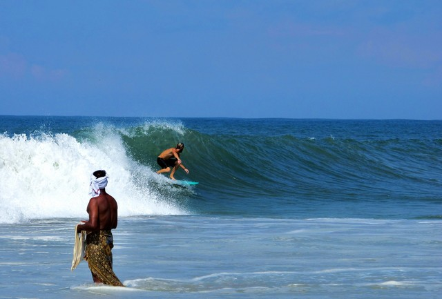 Surfing is becoming popular adventure activity in Varkala India