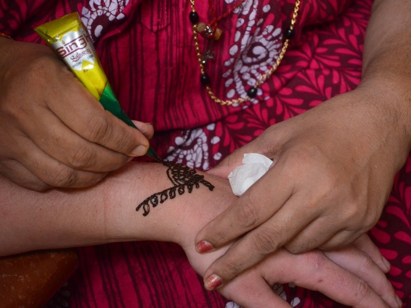 Henna or Mylanji is a form of body art in which decorative designs are created on a person's body, using a paste, created from the powdered dry leaves of the henna plant