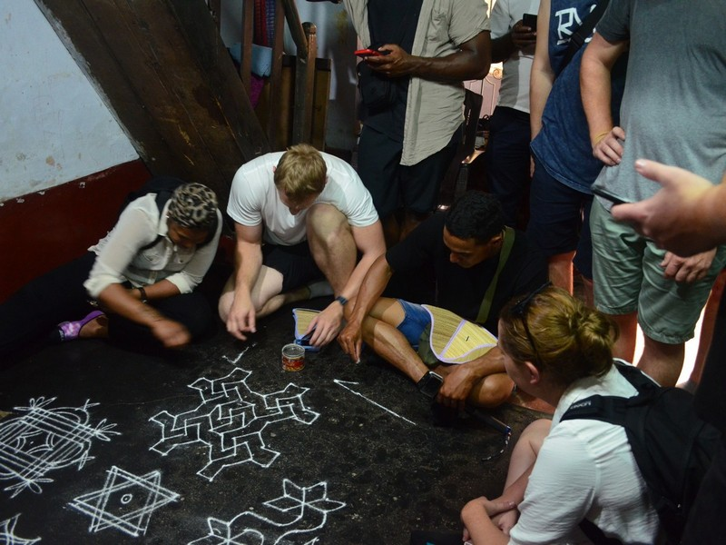 Trying Floral patterns or Kolam in Kochi Sightseeing Tour